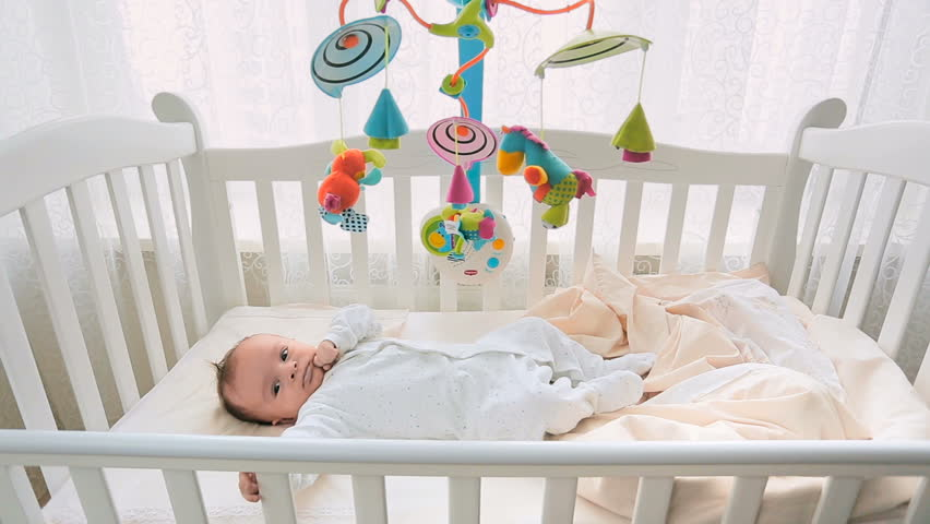 Baby Nursery Mobile Spinning On Top Of Baby Crib Baby