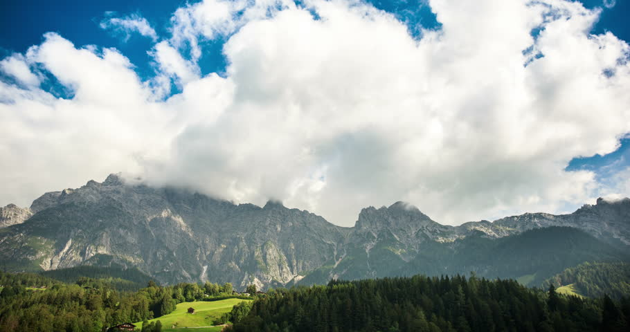 A beautiful landscape in the Alps with the fabulous meadows, pine trees, large rocks and amazing clouds flying over. An atmospheric timelapse 4K 50 fps video of 2 hours put in 12 seconds. | Shutterstock HD Video #19995049