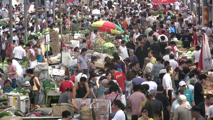 QINGDAO - JUNE 25: People are busy shopping for fruit and vegetables on June 25, 2010 in Qingdao, China.