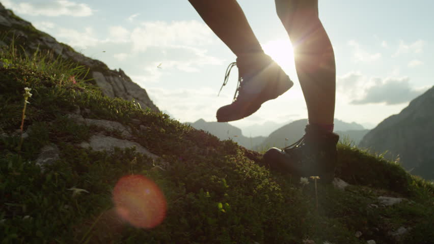 SLOW MOTION, CLOSE UP: Detail of vintage leather mountaineering boots and unrecognizable adventurous female hiker climbing mountain peak, hiking uphill on beautiful sunny summer day in European Alps | Shutterstock HD Video #20183806