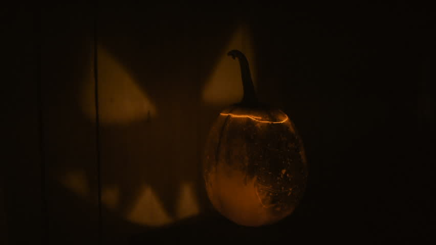 Scary carved halloween pumpkin. Image carved pumpkin scary picture on the wall. | Shutterstock HD Video #20300491