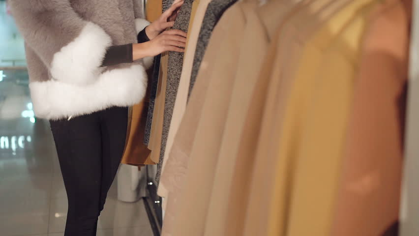 Fashionable lady choosing the fur coats in boutique | Shutterstock HD Video #20362438