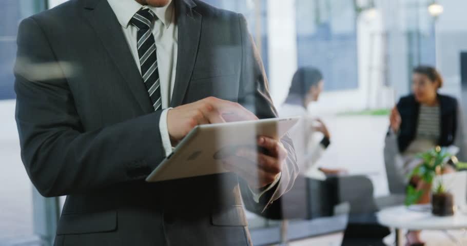 Smiling businessman using digital tablet in office 4k | Shutterstock HD Video #20399671