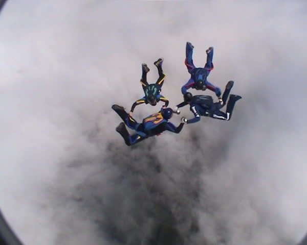 Four skydivers doing formations - SD stock footage clip