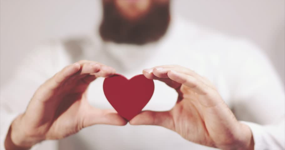Bearded man hands holding Heart shape Love symbol Valentines Day romantic greeting lifestyle feelings concept  | Shutterstock HD Video #20531962