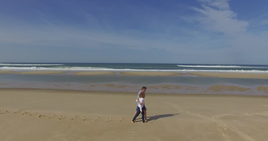 Man and woman on the beach | Shutterstock HD Video #20541385