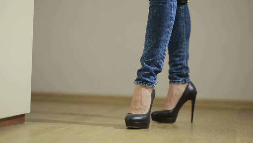 Girl in jeans with leather garter new fashion trends. straps on the hips | Shutterstock HD Video #20546668