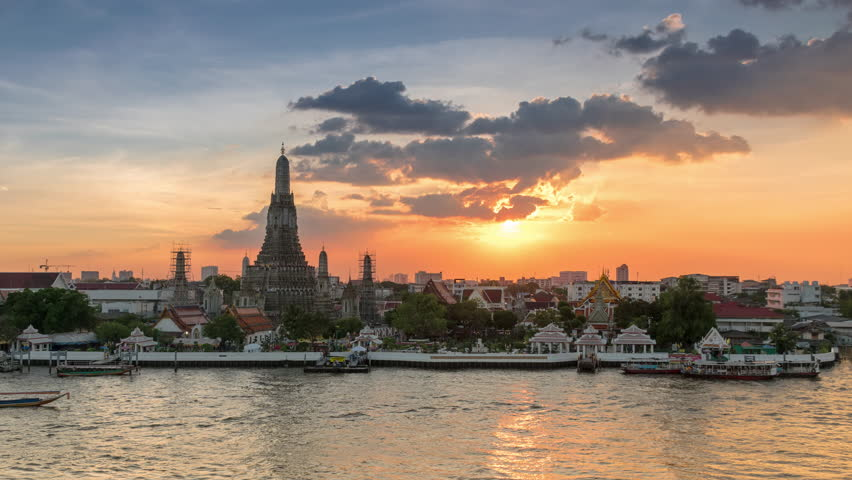 Time Lapse of Wat Arun Temple or (Wat Arun Ratchawararam Ratchawaramahawihan) with large moving clouds and sun rays | Shutterstock HD Video #20664424
