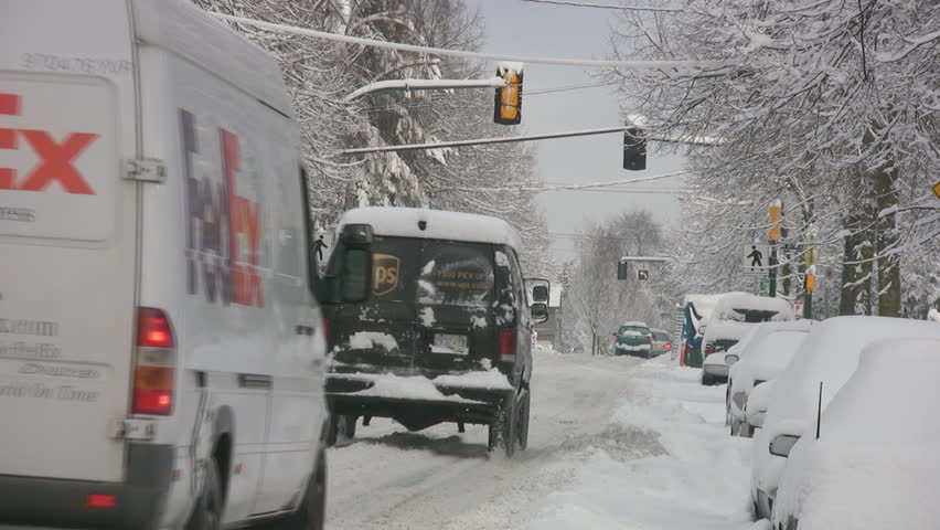 VANCOUVER, CANADA – DEC 24: Delivery trucks in Vancouver, British Columbia, Canada, Dec 26, 2008. Consecutive storms over the holiday season, broke snowfall records in many parts of western Canada.