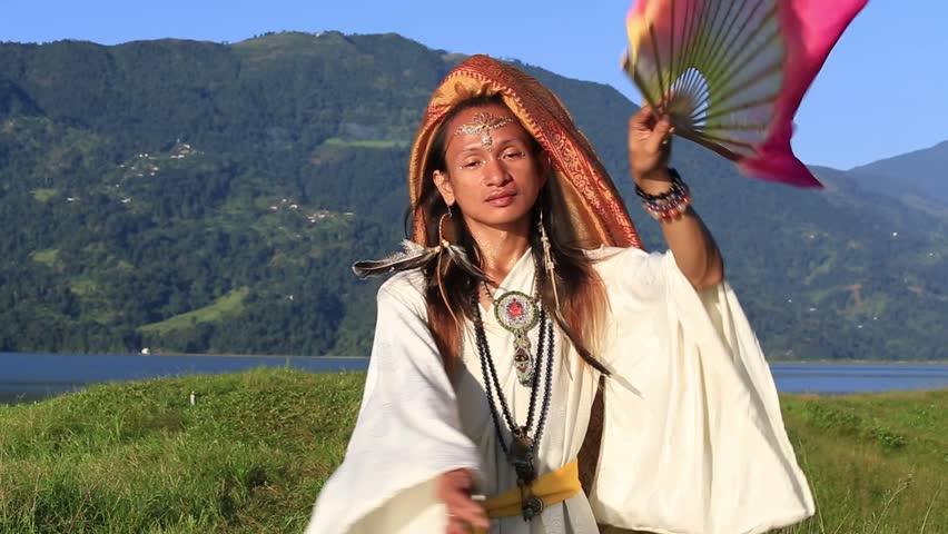 Shemale Sirena Sabiha dancing with a fan at sunrise in Pokhara, Nepal. Sirena was born in the Philippines. Close up