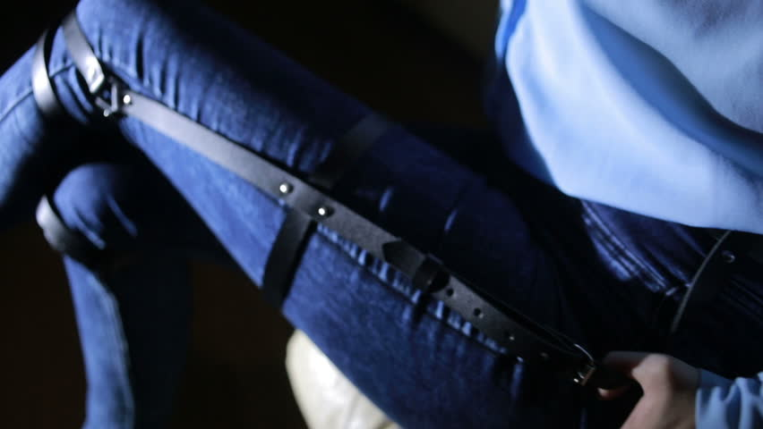 Girl in jeans with leather garter new fashion trends. straps on the hips | Shutterstock HD Video #20829565