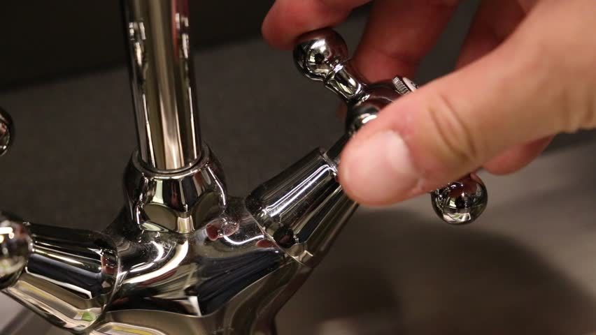 Young man opens the tap | Shutterstock HD Video #20909188