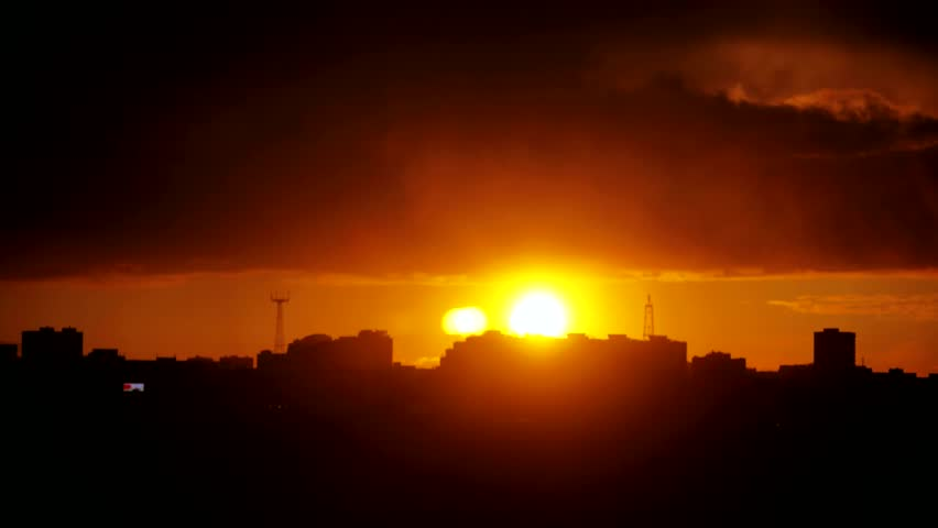 Timelapse of gorgeous sunset over silhouette city skyline. 3840x2160   Shutterstock HD Video #20976490