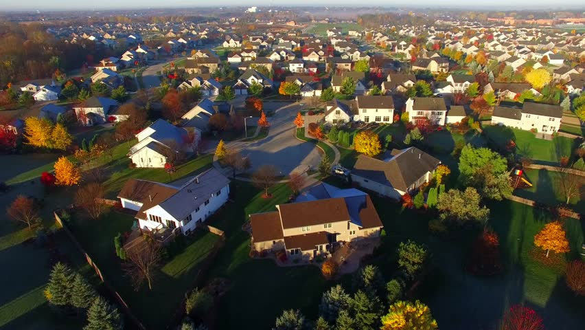 Tranquil idyllic wealthy Autumn neighborhood with frosty rooftops at sunrise, aerial view. | Shutterstock HD Video #21015928