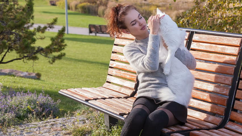 Young lady with Maine Coon cat | Shutterstock HD Video #21043108