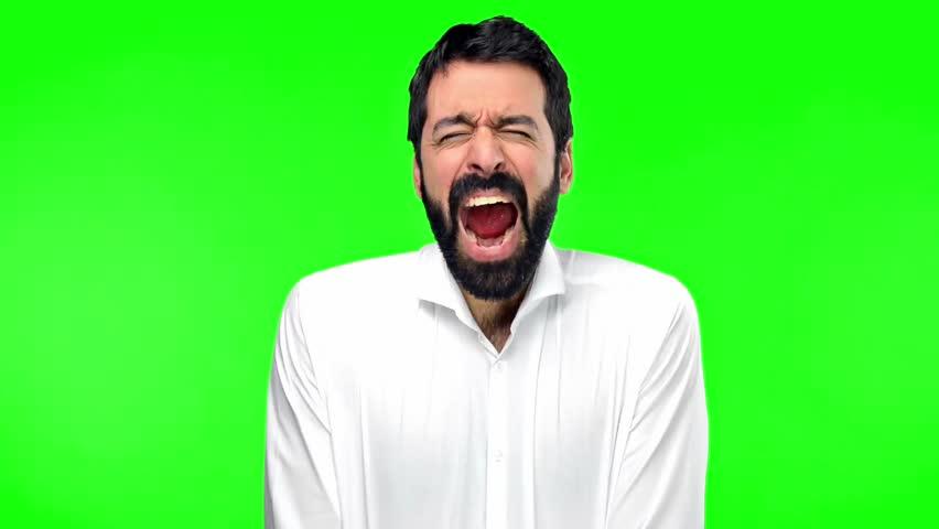 Handsome man shouting on green screen chroma key | Shutterstock HD Video #21060514