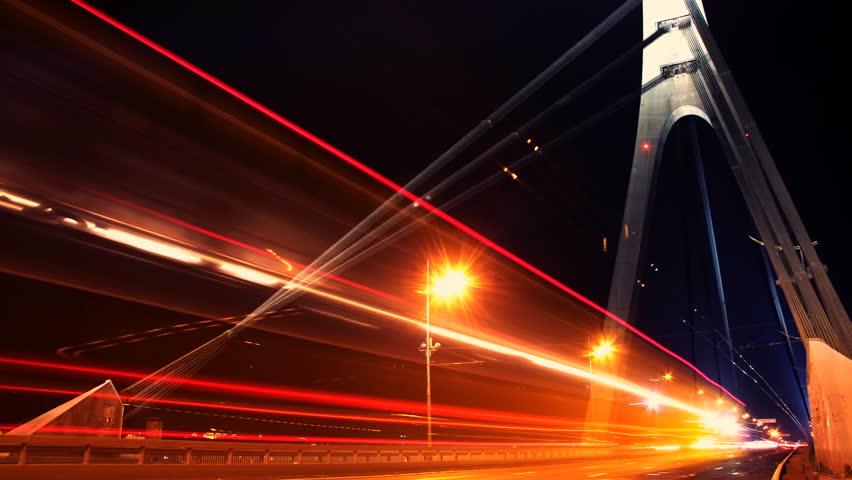 Time lapse of traffic going over Moskovskyi Bridge in Kiev at night - HD stock video clip