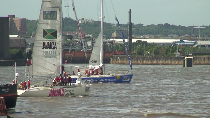 The Mersey Ferry passes in front of clipper's at the end of the 07-08 round the world clipper race July 6th - HD stock footage clip