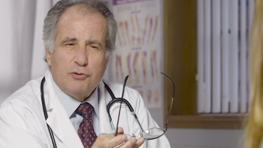 Medical Doctor talking with his patient in his office | Shutterstock HD Video #21168838