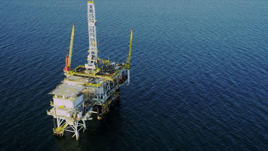 Aerial view of oil producing platform deep ocean, USA