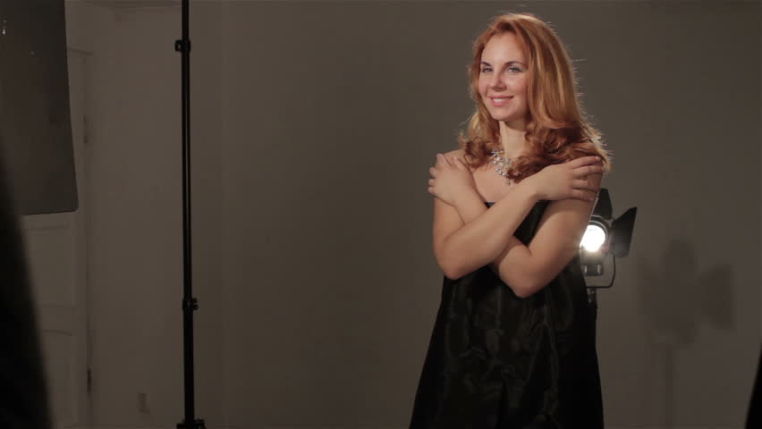 Redhead girl poses in studio. Montage. HD | Shutterstock HD Video #21305908