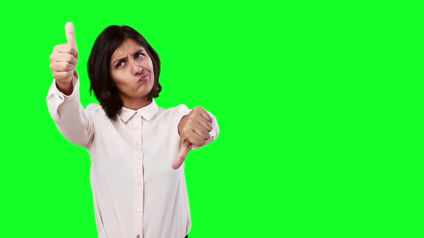 Latin woman doing a contradictory symbol on green screen   Shutterstock HD Video #21312685
