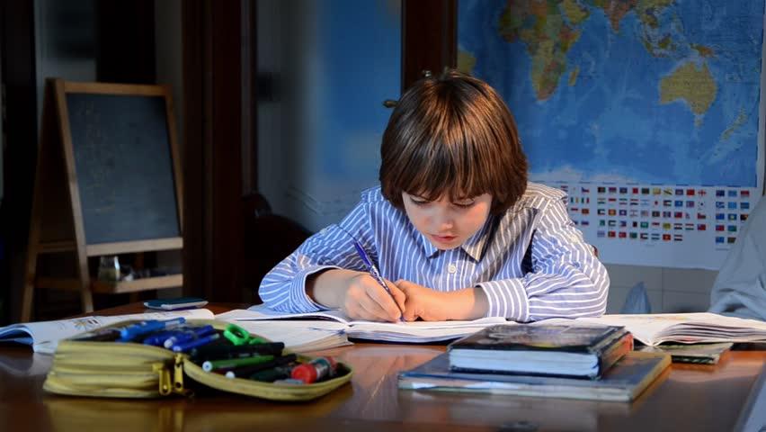 Child doing homework, studying books | Shutterstock HD Video #21488869