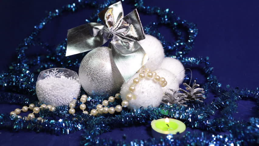 New Year's balls and ribbon on a blue background | Shutterstock HD Video #21589804