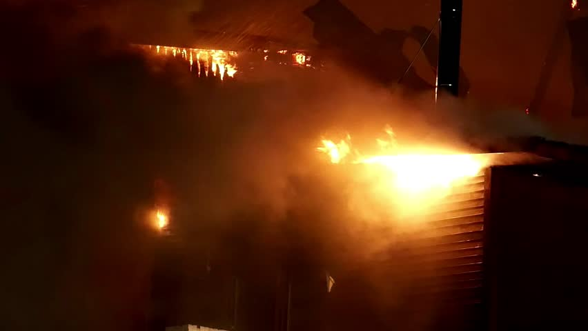 House building on fire at night. Inferno conflagration. - HD stock video clip