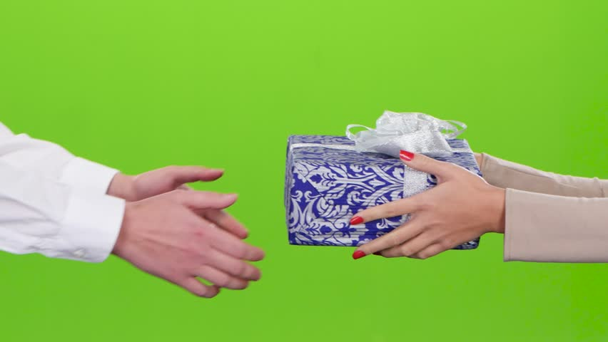 Gift in wrapping paper. Girl gives a man a box | Shutterstock HD Video #21692332