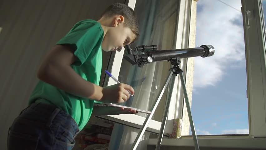 The Boy Looks in the Telescope Through an Open Window #21746287