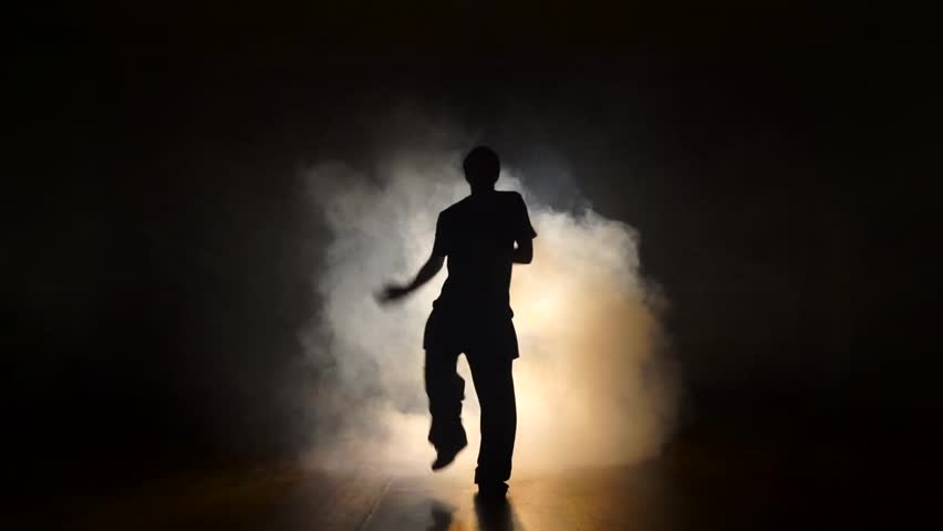 Dancer in the smoke in the dark. | Shutterstock HD Video #21777733
