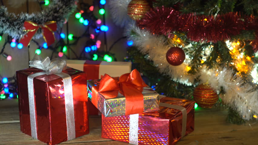 Christmas Gifts Under the Christmas Tree Lights Flashing Camera Movement #21944251