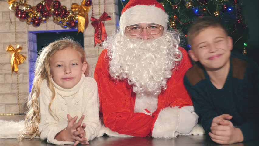 Santa and kids near the decorated Christmas tree. Wishes list | Shutterstock HD Video #21973465