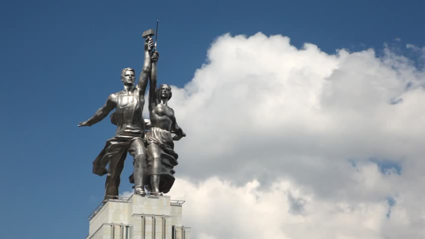 MOSCOW - JUN 10: Monument to worker and collective farmer stand against sky, Mukhina sculptor, on Jun 10, 2011 in Moscow, Russia. Sculpture was established on new pavilion pedestal on November 2009 - HD stock footage clip
