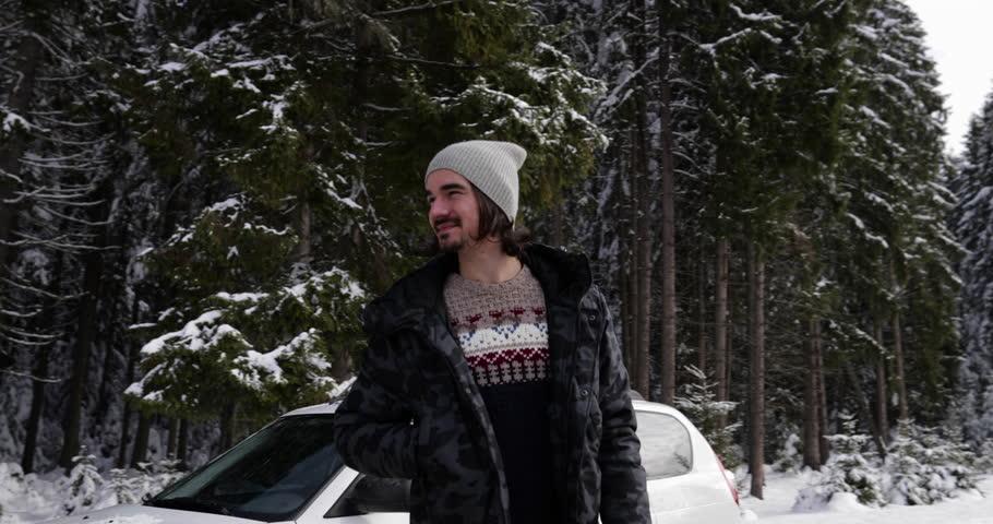 Man Near Car Winter Snow Forest Road In Snowy Mountain Park Slow Motion 60   Shutterstock HD Video #22041730
