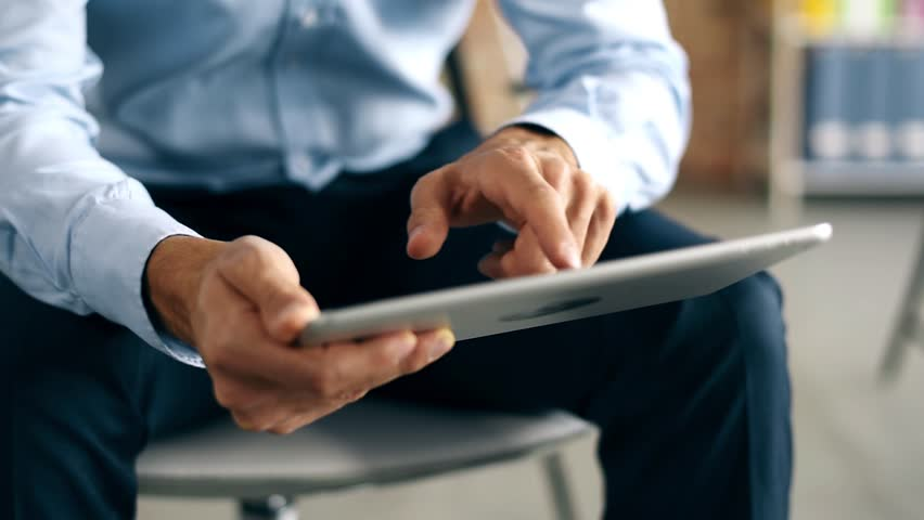 Businessman browsing his digital tablet | Shutterstock HD Video #22050658
