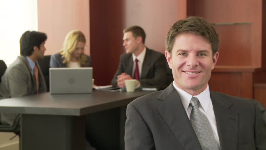Portrait of business executive with conference in background | Shutterstock HD Video #2205505