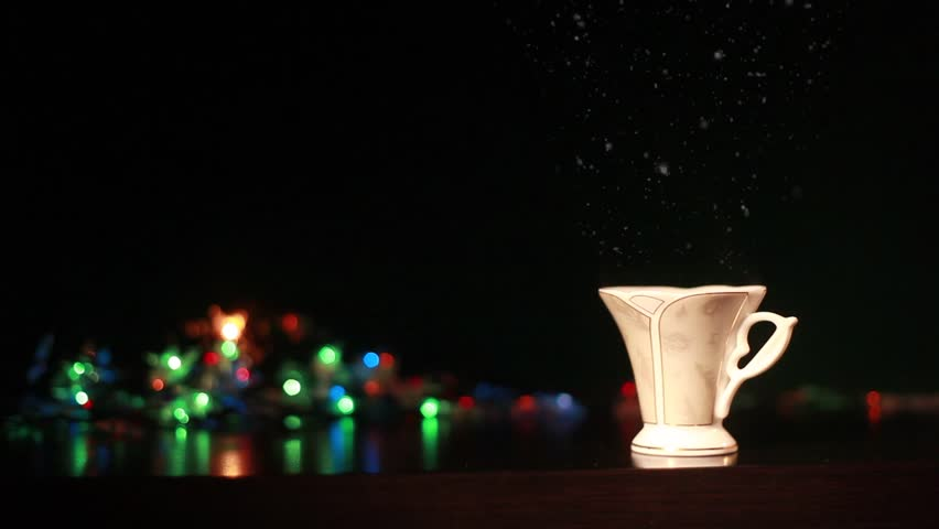 New Year Christmas. steam from a cup of coffee  | Shutterstock HD Video #22144924