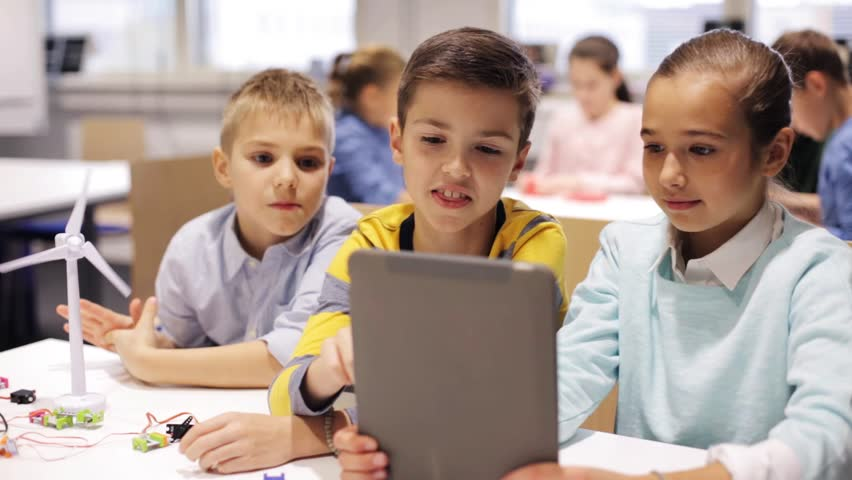 Education, science, technology, children and people concept - group of smiling kids or students with tablet pc computer programming electric windmill toy at robotics school lesson | Shutterstock HD Video #22194397