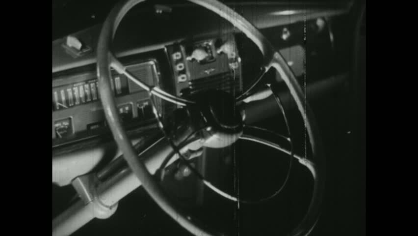 UNITED STATES, 1940s: steering wheel of car. Cotton. Man unloads stack of cotton into vat. | Shutterstock HD Video #22218598
