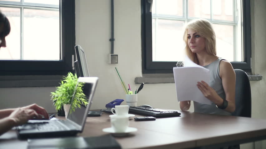 Two young businesswomen working in the office, stabilized shot - HD stock video clip