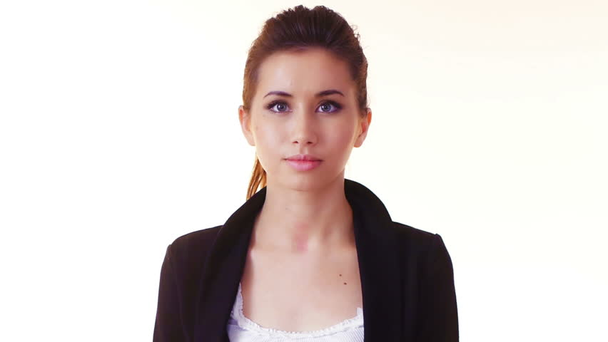 young businesswoman texting with mobile phone, serious look, over white