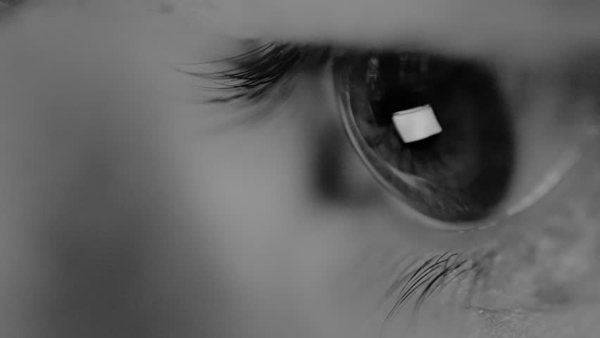 Macro view of young woman eye without cosmetics looks at the computer during working in the evening, the monitor reflects in her eyes | Shutterstock HD Video #22364911