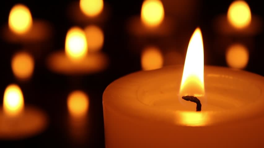 Candle light close up. Candle burning with bokeh lights on the background. Romantic candles