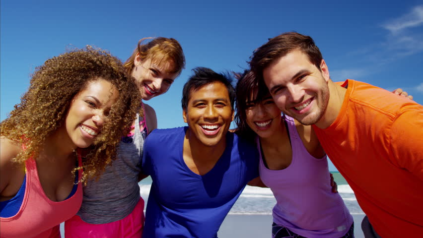 Portrait of smiling multi ethnic college friends making video diary on the beach RED DRAGON | Shutterstock HD Video #22437253