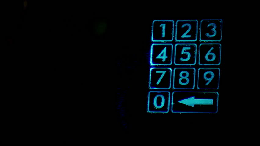 Male hand that enters short password to holographic number pad. Isolated blue holographic number pad on black background. Money is reliable protected by newest technology. | Shutterstock HD Video #22460320