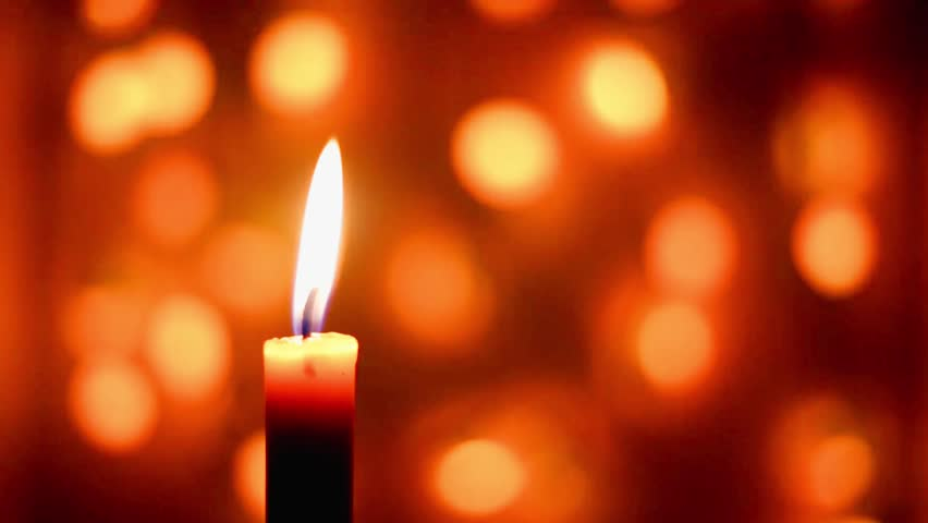 Close-up of a candle flame on a black background. Loop. | Shutterstock HD Video #22481011