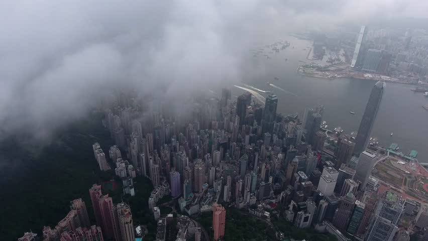Aerial video shot from clouds above modern infrastructure constructed district of Hong Kong city with tall skyscrapers during misty morning. Shooting can be used for advertising and filmmaking | Shutterstock HD Video #22522096