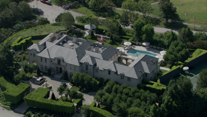 aerial view of an expansive 19th century mansion with manicured landscaping, pool, and surrounding property circa 2009 - HD stock video clip